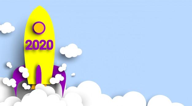 Numero del nuovo anno 2020 con razzo in carta tagliata e stile artigianale. simbolo del raggiungimento degli obiettivi per il 2020. start up company.