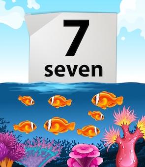 Numero sette con sette pesci che nuotano nel mare