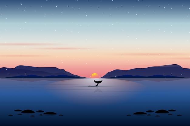 Nuoto della balena con il paesaggio al mare al tramonto