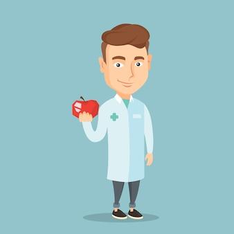 Nutrizionista che offre mela rossa fresca.