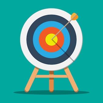 Obiettivo su treppiede in legno con freccia in centro.