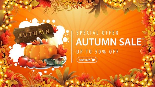 Offerta speciale, saldi autunnali, fino al 50% di sconto, banner sconto arancione con cornice di ghirlande decorate con foglie di autunno, forma astratta in stile graffiti e raccolta delle verdure