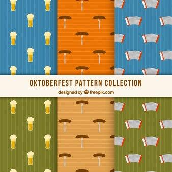 Oktoberfest modelli con fisarmonica, salsiccia e birra