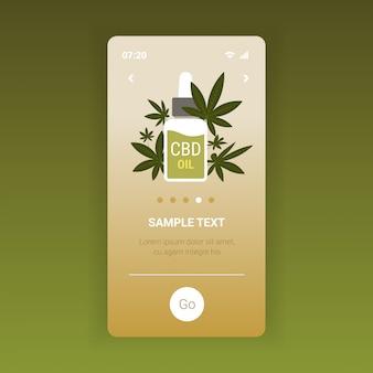 Olio di canapa cbd estratto dalla pianta di marijuana cannabis medica concetto di consumo di fango schermo dello smartphone app mobile spazio copia