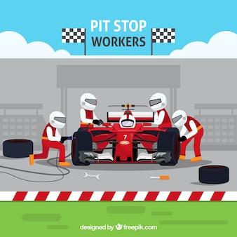Operai di pit-stop per auto da corsa
