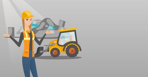 Operaio e bulldozer in discarica.