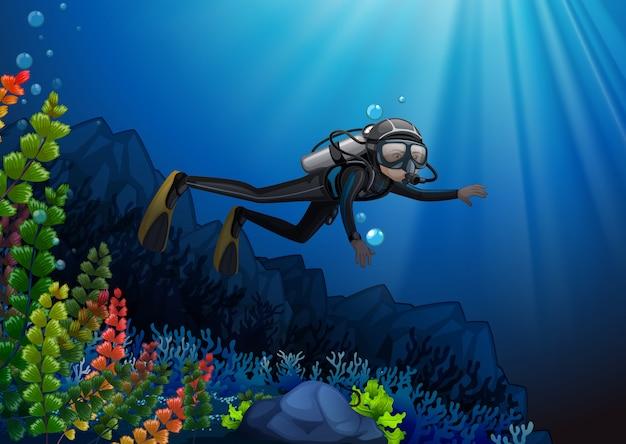 Operatore subacqueo di scuba in una scogliera