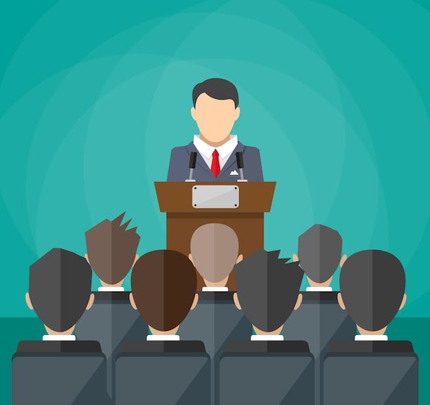 Oratore parla dalla tribuna. folla sulle sedie
