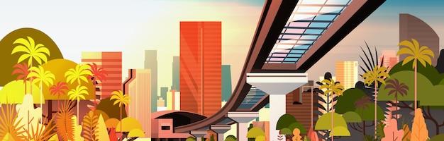 Orizzonte della città sul tramonto con l'illustrazione orizzontale di vista di paesaggio urbano della strada della ferrovia e dei grattacieli moderni