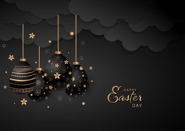 Ornamenti di pasqua neri e dorati che appendono la cartolina d'auguri