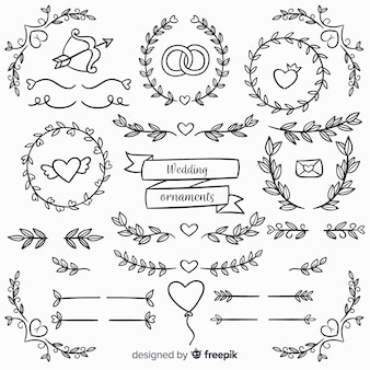 Ornamenti floreali di nozze disegnati a mano