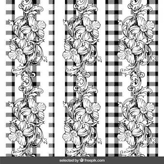 Ornamenti floreali su sfondo percalle