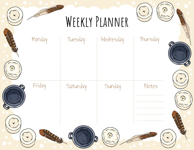 Ornamento di candele, piume e calderoni per agenda settimanale