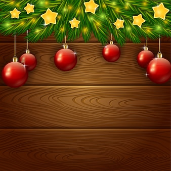 Ornamento di natale con stelle su fondo in legno