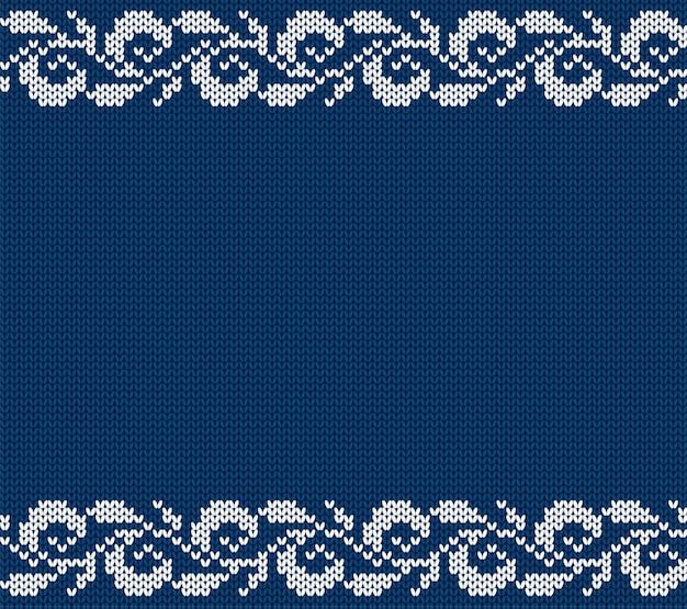 Ornamento floreale di natale blu lavorato a maglia. maglia invernale senza soluzione di sfondo.