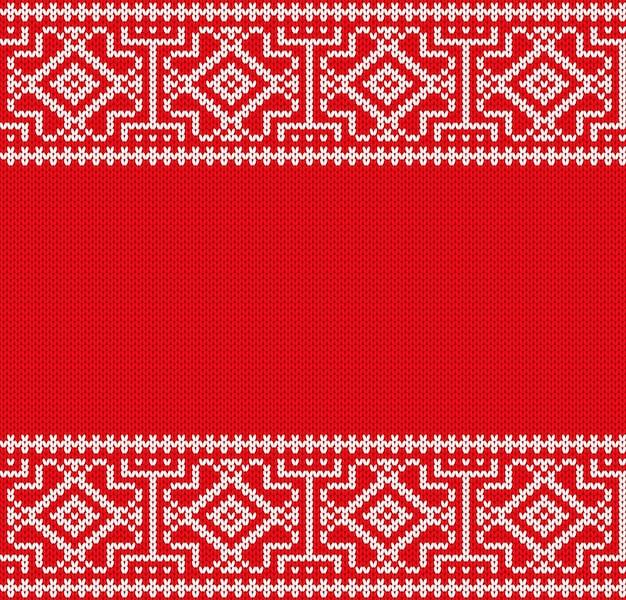 Ornamento geometrico di natale a maglia trama di maglione rosso invernale a maglia.