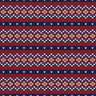 Ornamento senza cuciture sulla trama lavorata a maglia di lana.
