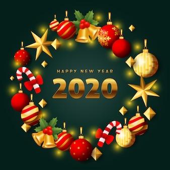 Oro di felice anno nuovo e corona rossa di natale su terra verde