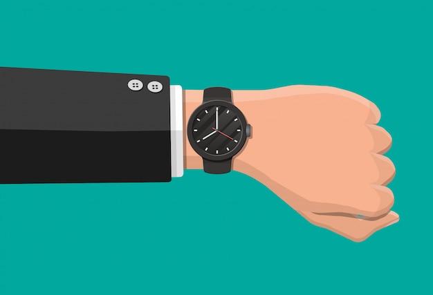 Orologio da polso a portata di mano. l'uomo controlla l'ora. tempo sull'orologio da polso. orologio nero con cinturino. illustrazione vettoriale in stile piatto