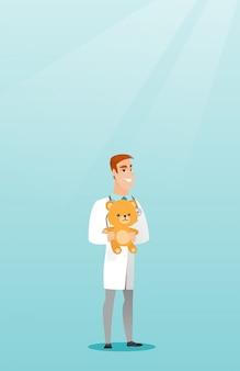 Orso dell'orsacchiotto della holding del medico del pediatra.