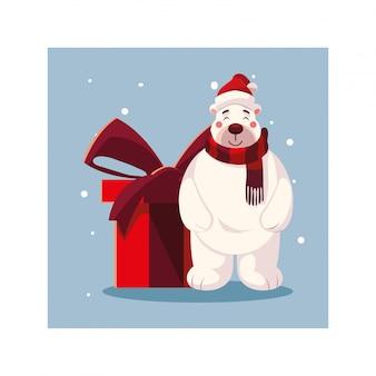 Orso polare con confezione regalo nel paesaggio invernale
