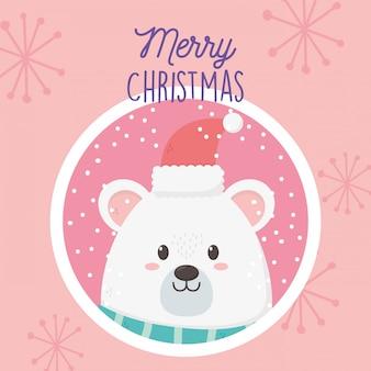 Orso polare con etichetta di buon natale cappello e fiocchi di neve