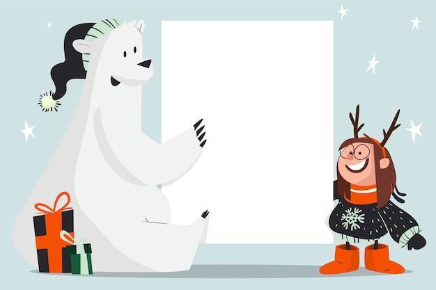 Orso polare di natale che tiene modello in bianco dell'insegna