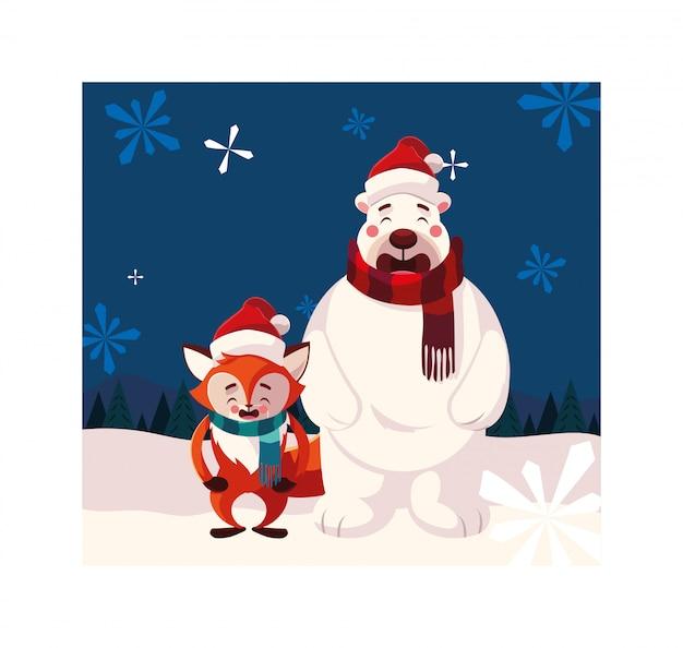Orso polare e volpe con cappello nel paesaggio invernale