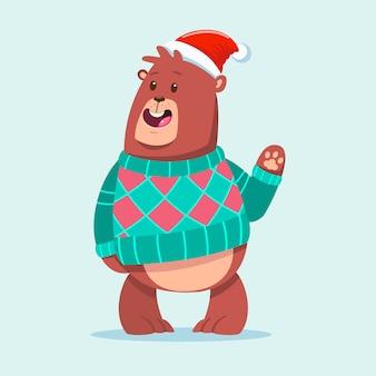 Orso sveglio in un personaggio animale divertente del fumetto brutto maglione di natale isolato sopra.