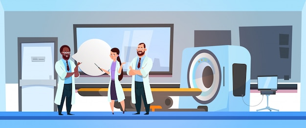 Ospedale di team of doctors over mri machine scanner