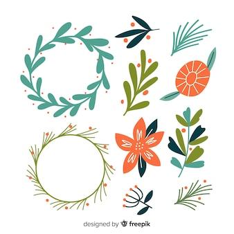 Pacchetto di fiori e corona di natale disegnati a mano