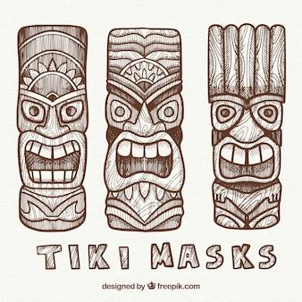 Pacchetto disegnato a mano di maschere tiki tribali