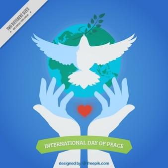 Pace giorno sfondo di mani rilasciando una colomba