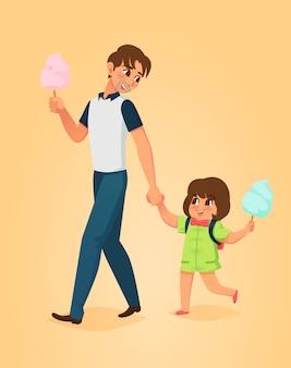 Padre e figlia mangiano zucchero filato.
