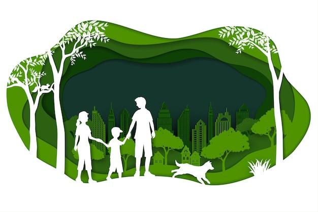 Paesaggio con eco città verde e famiglia felice