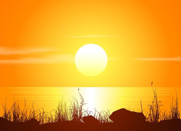 Paesaggio con tramonto in riva al mare.