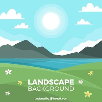 Paesaggio decorativo con lago e montagne