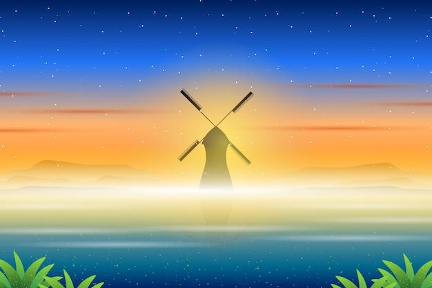 Paesaggio del mulino a vento e del cielo variopinto