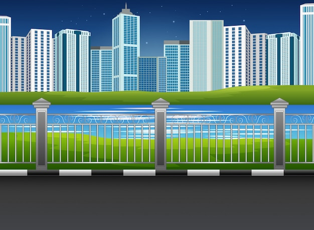 Paesaggio del parco della città con il fiume e fondo urbano