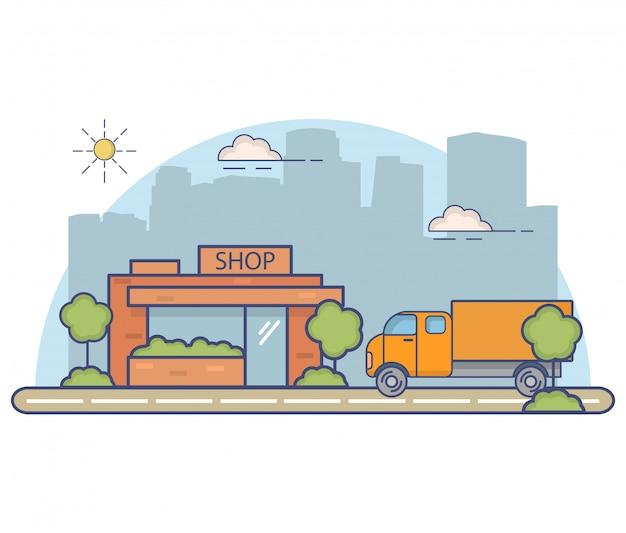 Paesaggio della città con la costruzione del negozio e il camion.