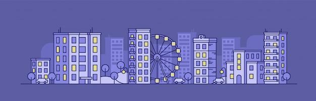 Paesaggio della città con la ruota panoramica nella notte
