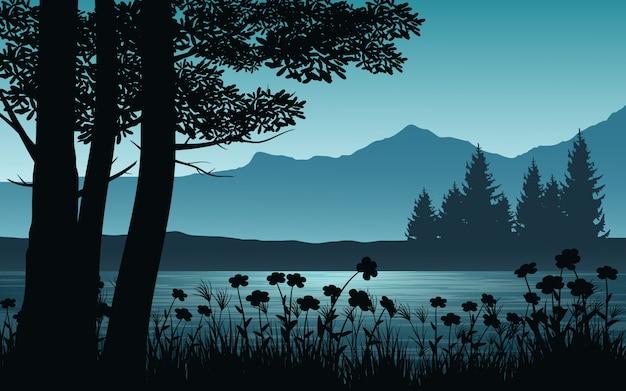 Paesaggio della foresta con la siluetta dell'albero e del fiume