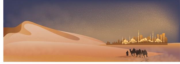 Paesaggio di panorama del viaggio arabo con cammelli attraverso il deserto con moschea, dune di sabbia e polvere