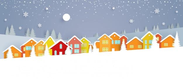Paesaggio invernale con case colorate