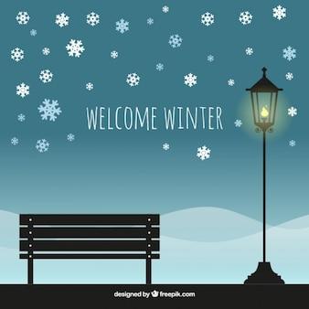 Paesaggio invernale sfondo con panca e lampione