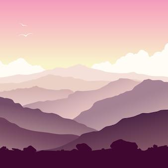 Paesaggio montano con erba e lago enorme