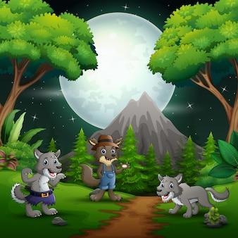 Paesaggio notturno nella foresta con tre lupi