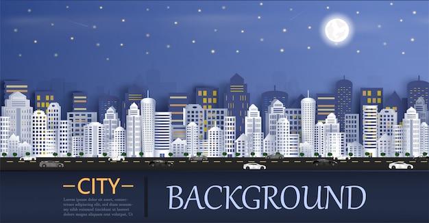 Paesaggio urbano con un gruppo di grattacieli nella notte.