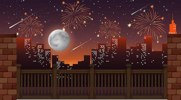 Paesaggio urbano con vista di fuochi d'artificio di celebrazione dal ponte