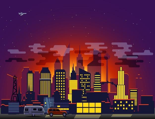 Paesaggio urbano moderno con illuminazione notturna.